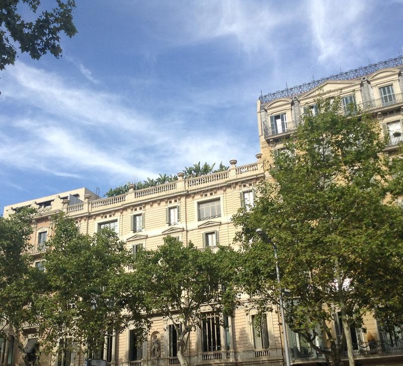 Hello from the terrace. Barcelona, a beautiful french style building with a gracious garden on the terrace in the boulevard Passeig de Gracia royalty free stock photos