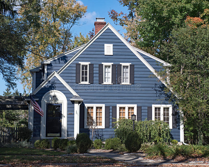 Blue Wood Sided House. Quaint small house or cottage with blue wood siding royalty free stock photos