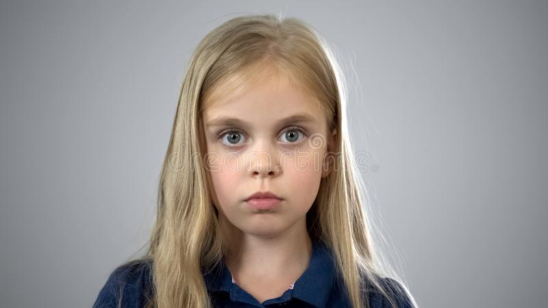 Child custody, portrait of scared schoolgirl, searching for parents, adoption. Stock photo royalty free stock photos