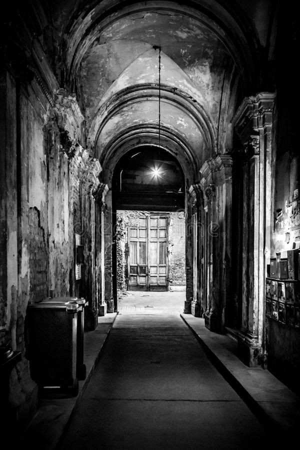 Crumbling, decayed entrance hallway of a building in downtown of Budapest, Hungary royalty free stock photography