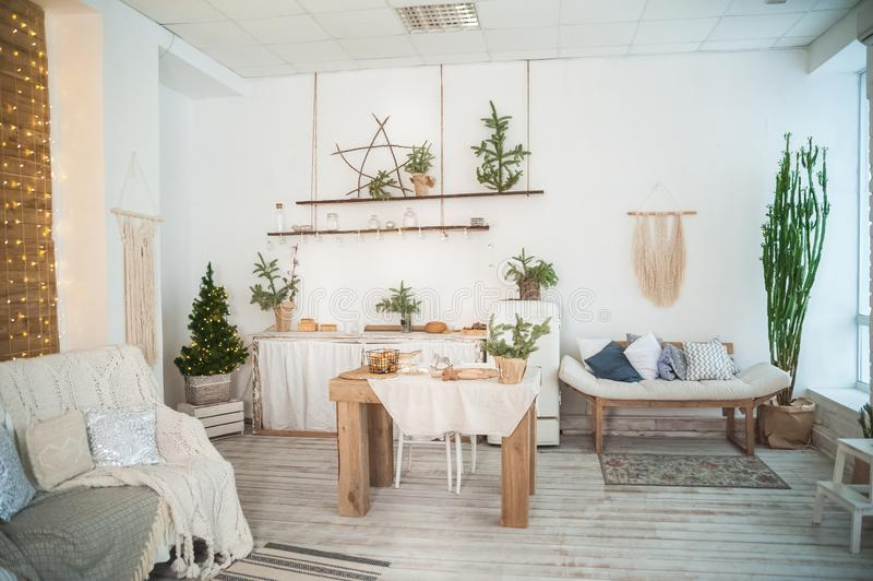 Details of the decorated New Year`s interior. Scandinavian living room and kitchen for Christmas. The comfort of homely rustic dec stock image