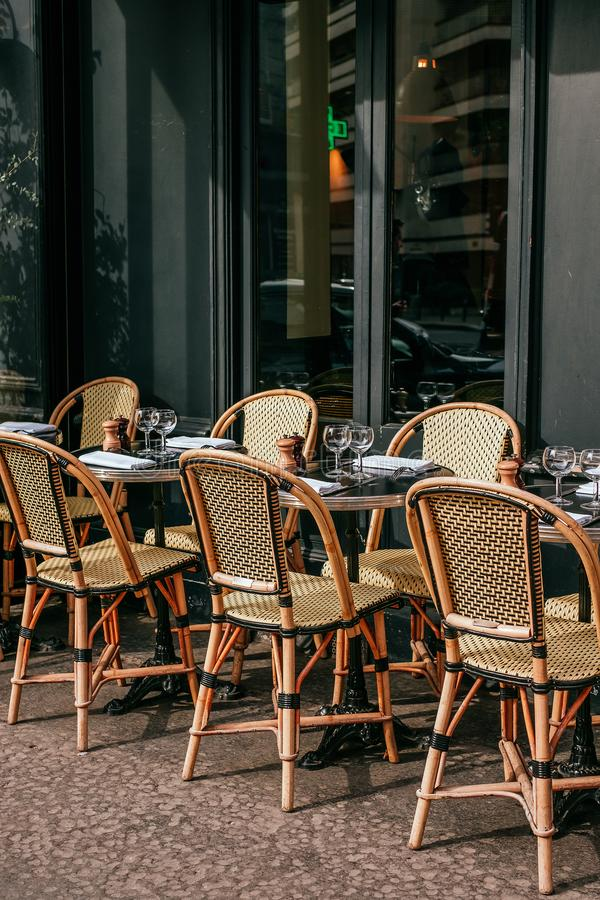 French cafe terrace. Paris, France - April 8, 2019: Charming traditional french cafe with tables on terrace, landmark in Paris stock image