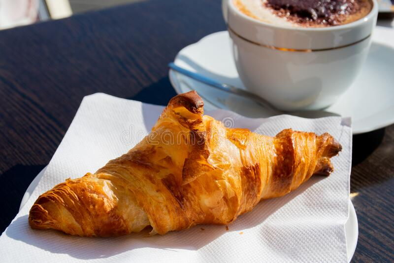 French croissant breakfast continental at the hotel or terrace. stock images