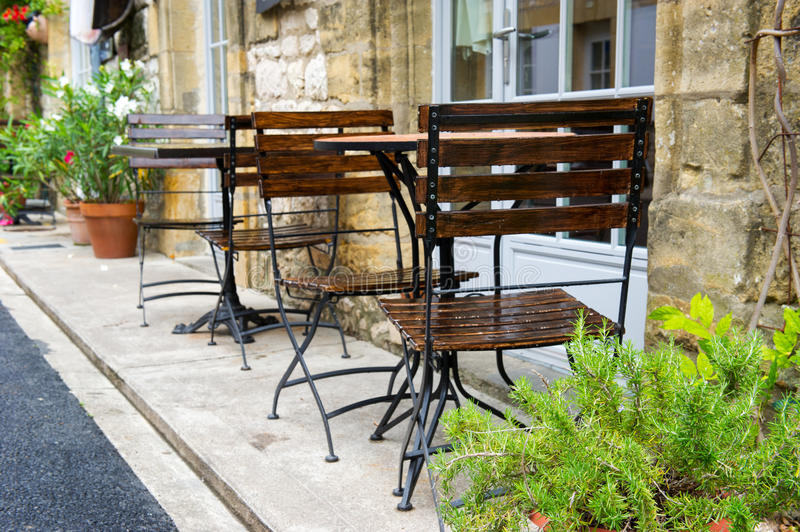 French terrace. Empty French terrace with tables and chairs stock photos