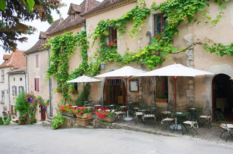 French terrace in village. Terrace in village Saint-cirq-Lapopie in France stock photos
