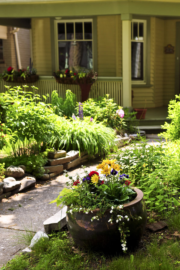 Front yard of a house. Landscaped front yard of a house with flowering garden and walkway stock photo