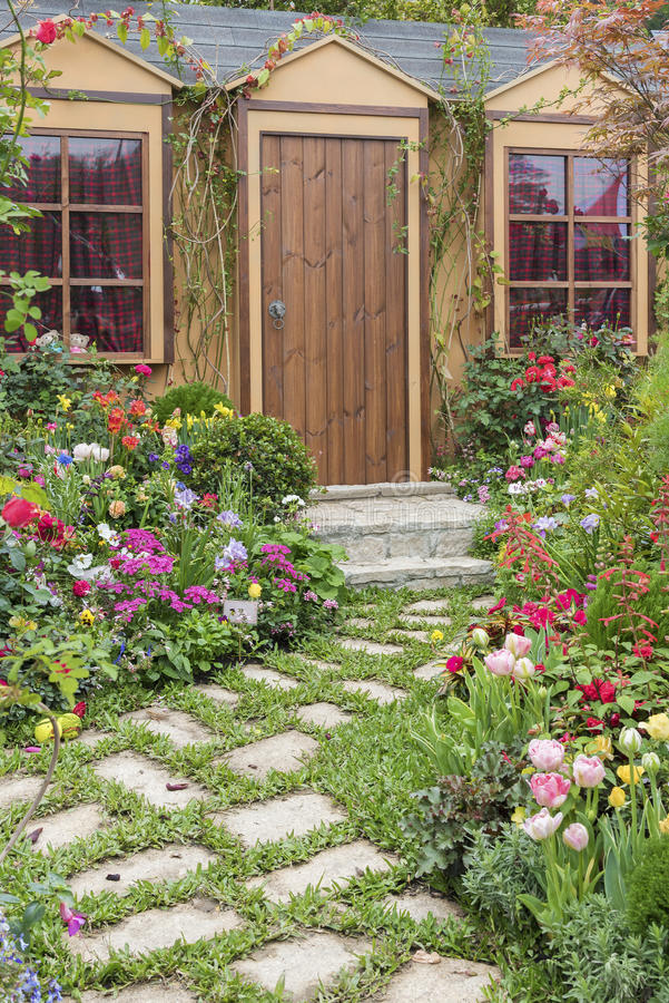 House with flower garden. Landscaped backyard of house with flower garden royalty free stock image