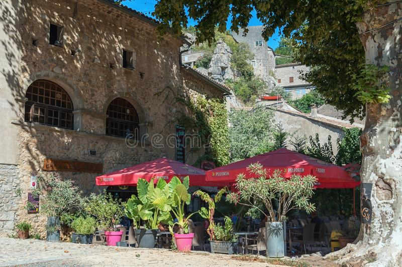 Restaurant with terrace under the platans in the picturesque village of Labeaume. Labeaume, France, September 7, 2016: Restaurant with terrace under the platans stock photos