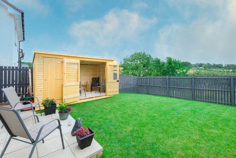Modern Garden Designed and landscaped with newly Constructed Materials Including New Summer House Silver Copse painted Fencing and. A newly completed and stock photos