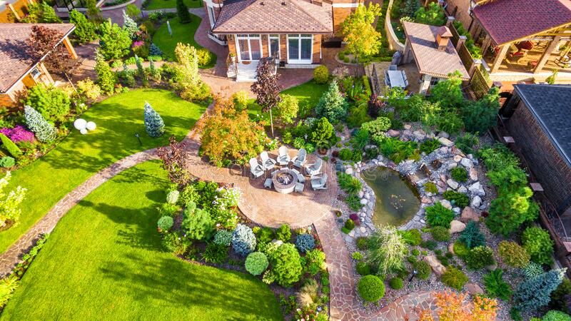 Landscape design with patio at residential house taken from above. Beautiful landscaping in home garden in summer. Moscow Region - Aug 24, 2019: Landscape design stock image