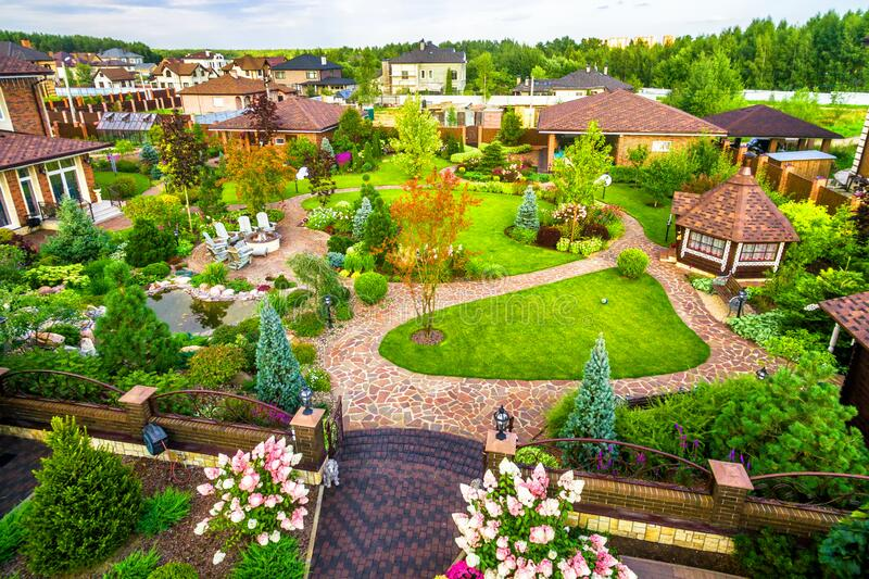 Landscape design at residential house taken from above. Beautiful landscaping in home garden in summer. Moscow Region - Aug 24, 2019: Landscape design at royalty free stock photos