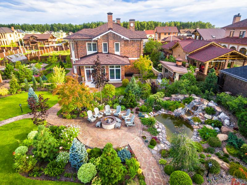 Landscape design at residential house taken from above. Beautiful landscaping in home garden in summer. Moscow Region - Aug 24, 2019: Landscape design at stock photography