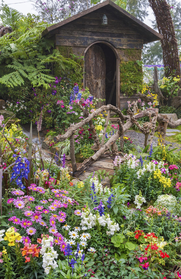 Old house with flower garden. Landscaped backyard of a old house with flower garden royalty free stock photo