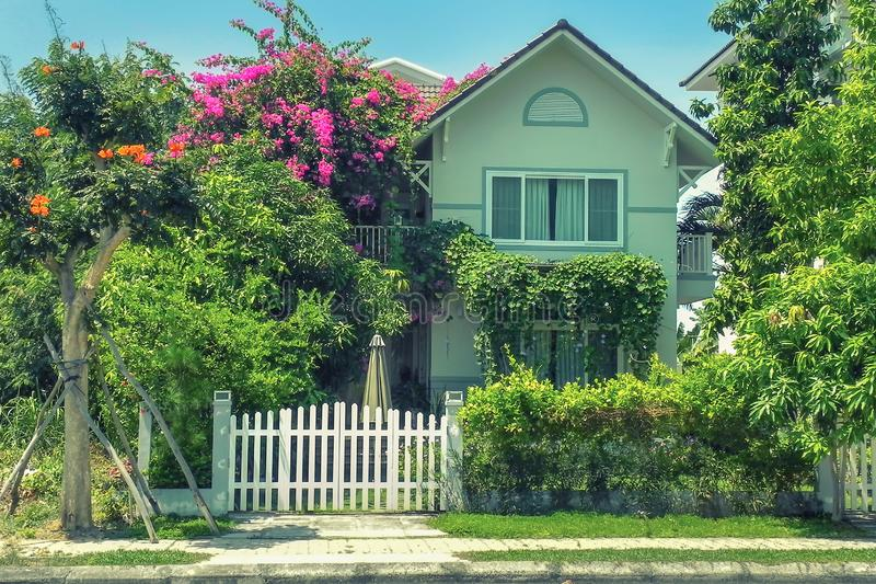 One Small cozy two-storey house with p trees. And landscape design in the summer. An Vien. Nha trang. Vietna royalty free stock image