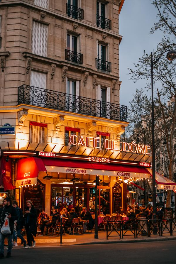 French cafe terrace. Paris, France - April 6, 2019: Charming traditional french cafe with tables on terrace in evening, landmark in Paris stock photos