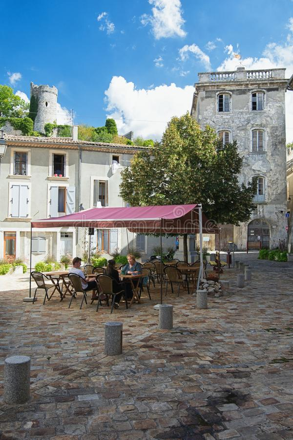 People sitting on a terrace on a square in the small village Saint Montan in the Ardeche region of France. Saint Montan, France, September 15, 2016: People royalty free stock photography