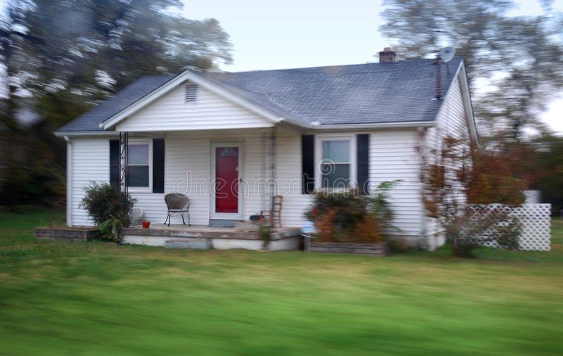 Small country home. Small country home in historic Nashville. Motion blur on house, porch in focus royalty free stock images