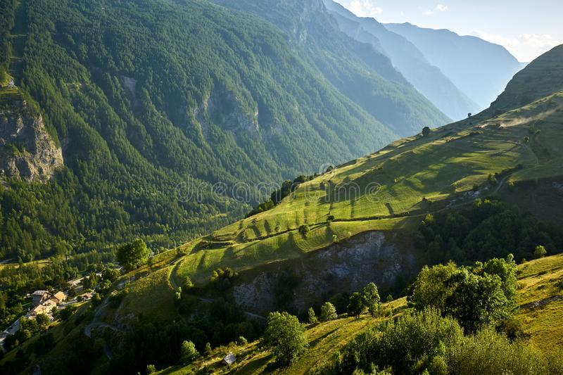 Terrace farming in the Ecrins National Park in summer. Hautes-Alpes, French Alps, France. Terrace farming in the Romanche Valley in summer. Le Chazelet, Ecrins stock photo