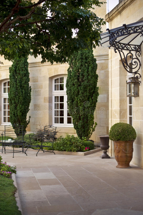 Terrace of a French mansion. Garden and furniture on the terrace of a French manion near Bordeaux stock photos
