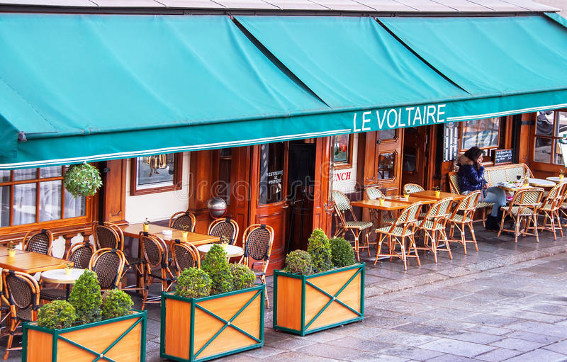 Traditional parisian cafe named after the french writer Voltaire. Paris, France - January 9, 2015. Traditional parisian cafe. Cafe le Voltaire named after the stock photos