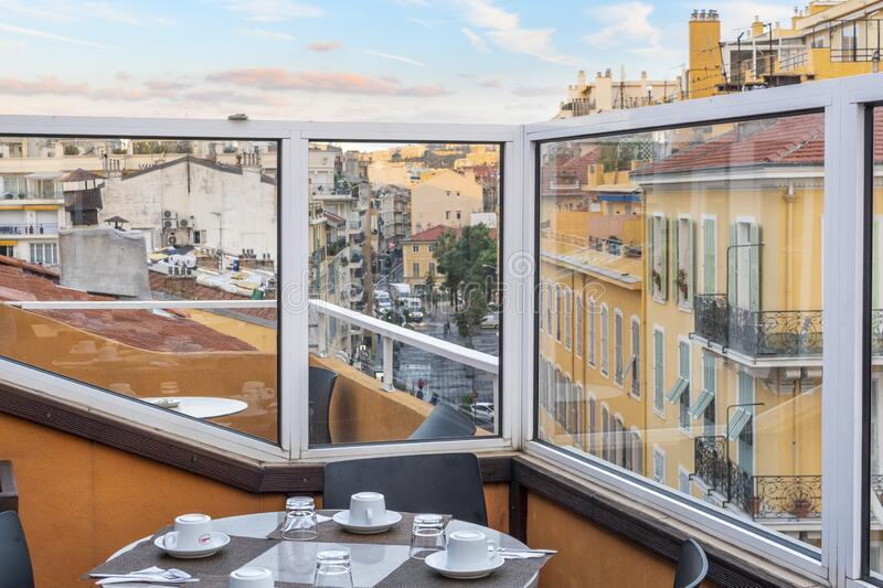 View of the city of Nice, France, on the Mediterranean French Riviera from a rooftop cafe terrace. stock photo
