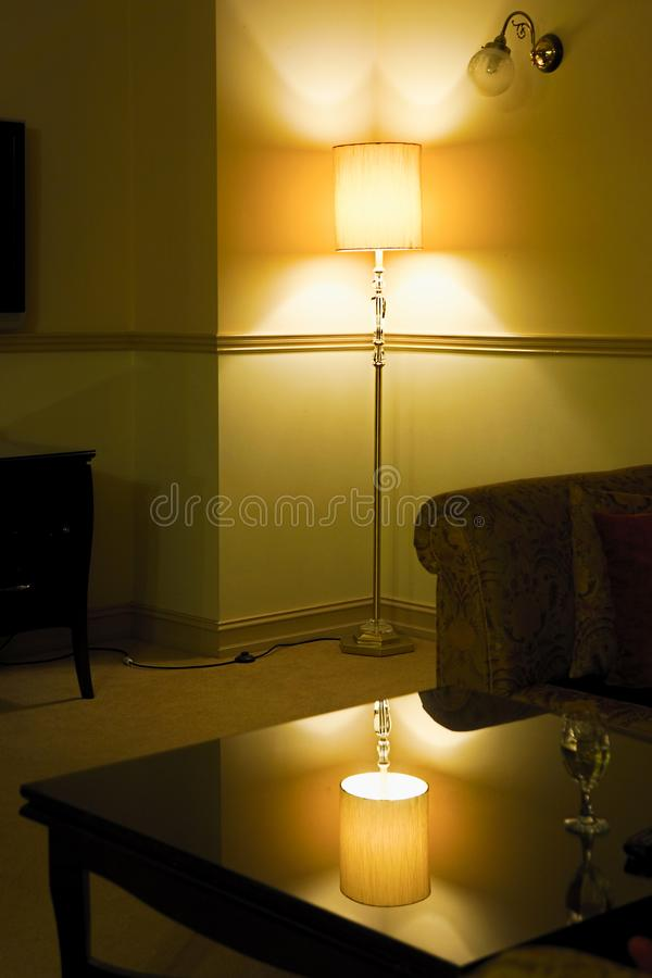Warm homely room with lamp royalty free stock image
