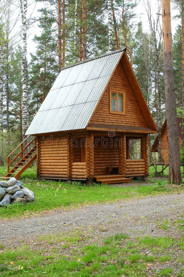 Wooden small house in a wood. For travellers stock photos